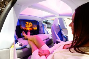 model-poses-rinspeed-xchange-electric-powered-autonomous-driving-concept-car